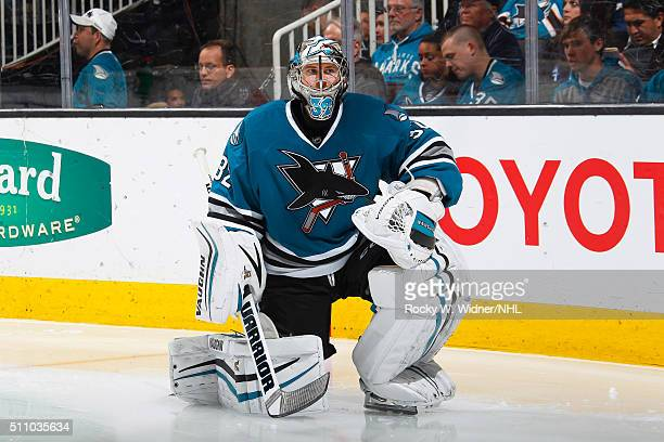 Alex Stalock of the San Jose Sharks looks on during the game against the Calgary Flames at SAP Center on February 11 2016 in San Jose California