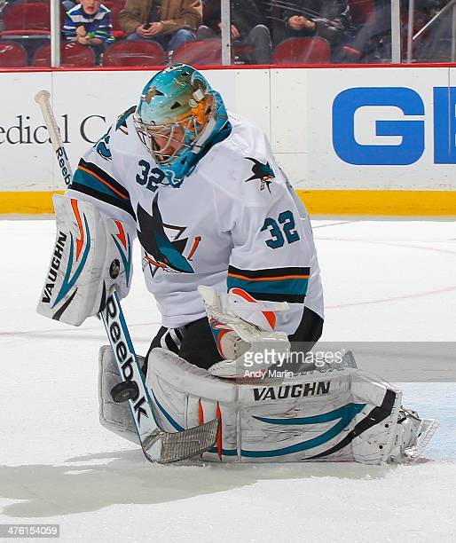 Alex Stalock of the San Jose Sharks makes a stick save against the New Jersey Devils during the game at the Prudential Center on March 2 2014 in...