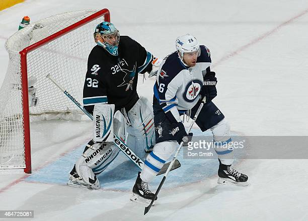 Alex Stalock of the San Jose Sharks protects the net against Blake Wheeler of the Winnipeg Jets during an NHL game on January 23 2014 at SAP Center...