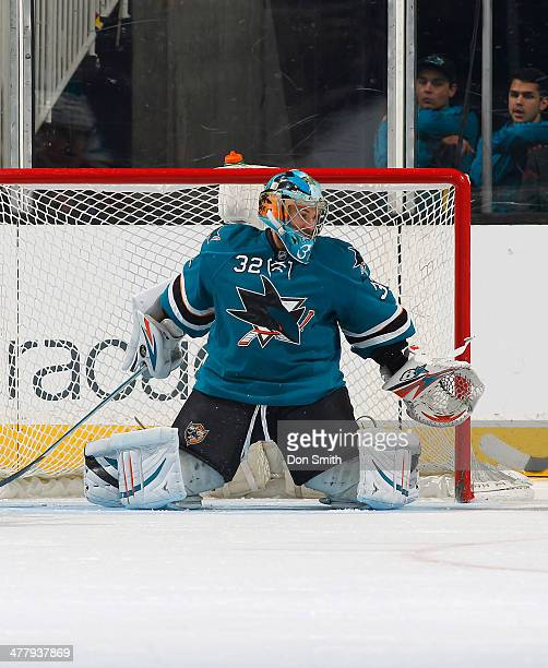 Alex Stalock of the San Jose Sharks protects the net against the Carolina Hurricanes during an NHL game on March 4 2014 at SAP Center in San Jose...