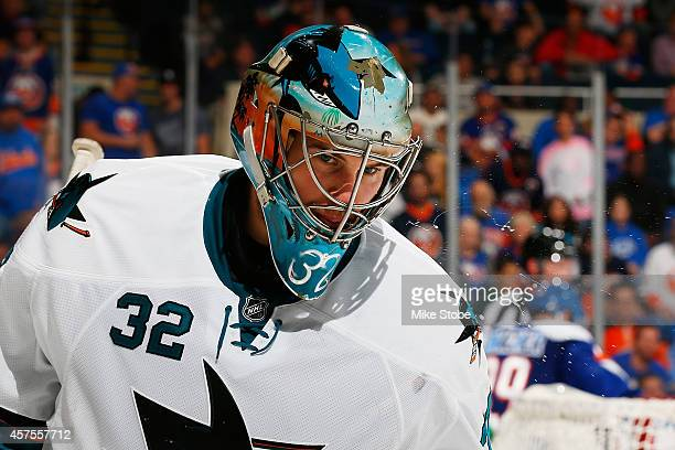 Alex Stalock of the San Jose Sharks skates against the New York Islanders at Nassau Veterans Memorial Coliseum on October 16 2014 in Uniondale New...
