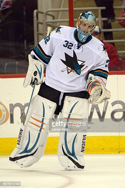 Alex Stalock of the San Jose Sharks skates on the ice against the Carolina Hurricanes at PNC Arena on December 6 2013 in Raleigh North Carolina The...