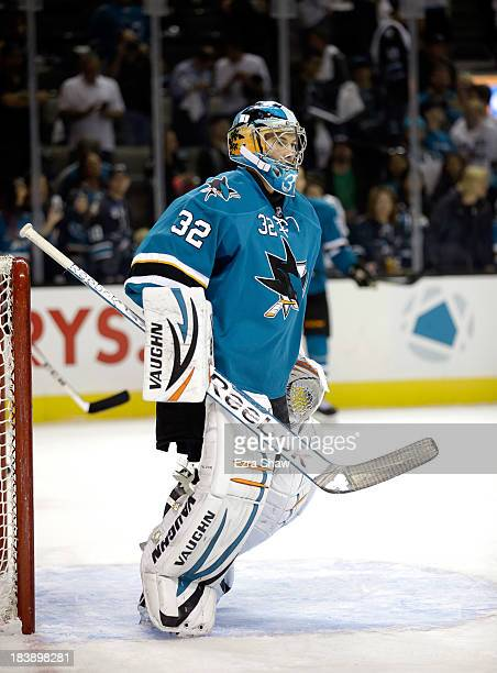 Alex Stalock of the San Jose Sharks warms up before their game against the Vancouver Canucks at SAP Center on October 3 2013 in San Jose California