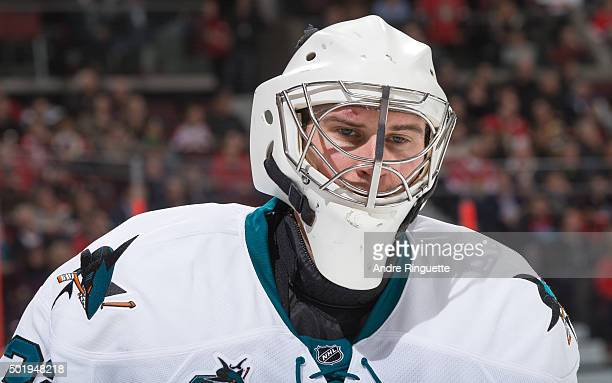 Alex Stalock of the San Jose Sharks wears a blank white face mask after getting breaking his game mask during the third period of a game against the...