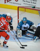 Alex Stalock of the Worcester Sharks defends the net against the Charlotte Checkers at the DCU Center on November 27 2010 in Worcester Massachusetts