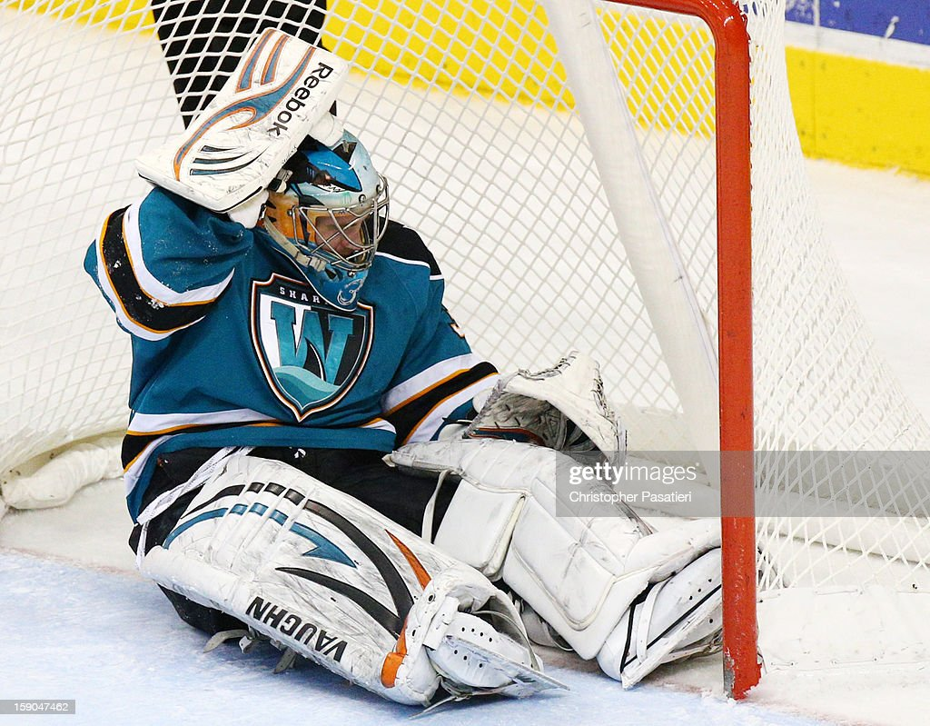 <a gi-track='captionPersonalityLinkClicked' href=/galleries/search?phrase=Alex+Stalock&family=editorial&specificpeople=1966875 ng-click='$event.stopPropagation()'>Alex Stalock</a> #32 of the Worcester Sharks holds his head during an American Hockey League game against the Hershey Bears on January 6, 2013 at the Giant Center in Hershey, Pennsylvania.