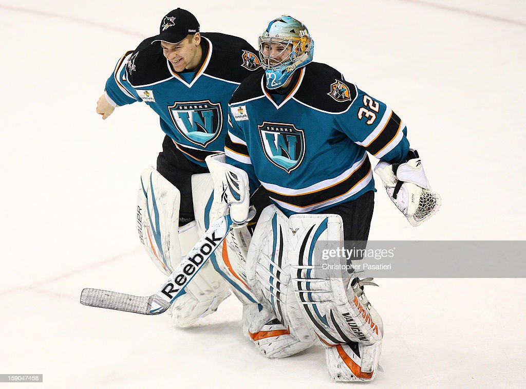 <a gi-track='captionPersonalityLinkClicked' href=/galleries/search?phrase=Alex+Stalock&family=editorial&specificpeople=1966875 ng-click='$event.stopPropagation()'>Alex Stalock</a> #32 of the Worcester Sharks skates off the ice with Harri Sateri #35 after defeating the Hershey Bears 2-1 during an American Hockey League game on January 6, 2013 at the Giant Center in Hershey, Pennsylvania.