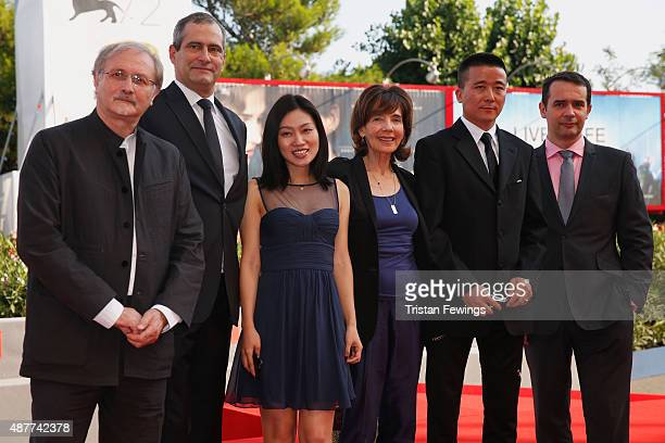 Alex Szalat Laurent Vallet Hu Mengchu Sylvie Blum director Zhao Liang and Fabrice Blancho attend a premiere for 'Behemoth' during the 72nd Venice...