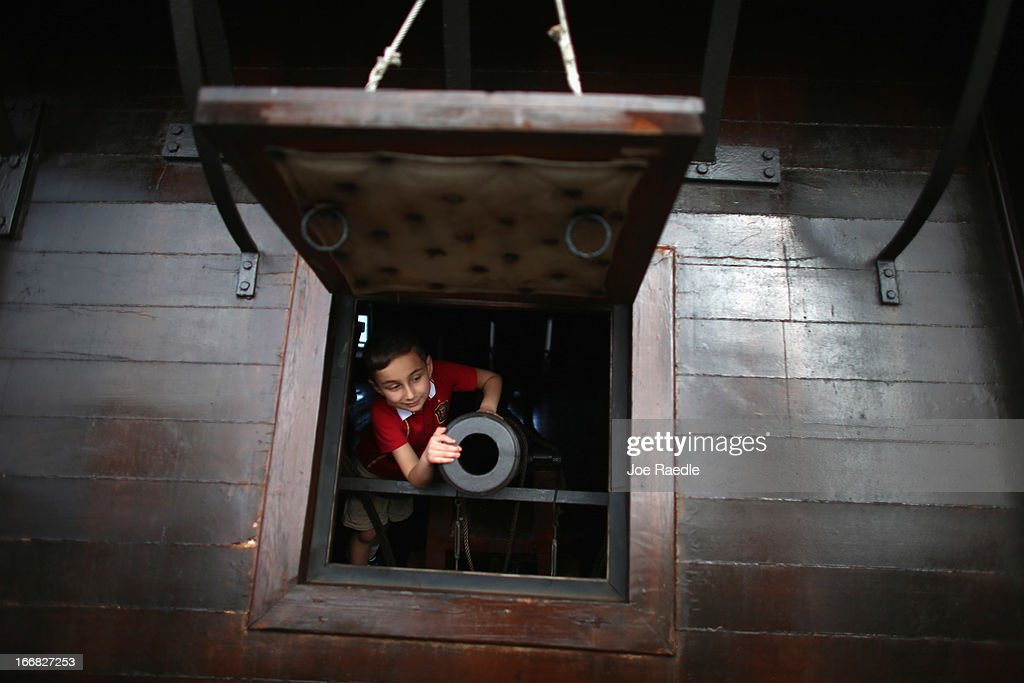 Alex Tabares checks out one of the canons aboard El Galeón, a replica of a 16th century galleon, during Florida's commemoration of the 500th anniversary of Spanish explorer Juan Ponce de Leon's arrival on the shores of Florida on April 17, 2013 in Miami, Florida. The boat will remain in Miami until April 28, after which it continues North along Florida's east coast and stops along the way in Fort Lauderdale, Cape Canaveral, and St. Augustine.