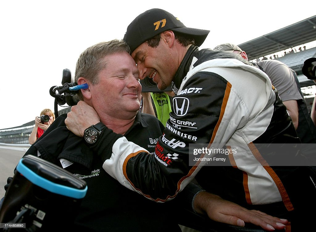 <a gi-track='captionPersonalityLinkClicked' href=/galleries/search?phrase=Alex+Tagliani&family=editorial&specificpeople=220628 ng-click='$event.stopPropagation()'>Alex Tagliani</a> driver of the #77 Bowers & Wilkens/<a gi-track='captionPersonalityLinkClicked' href=/galleries/search?phrase=Sam+Schmidt&family=editorial&specificpeople=1063280 ng-click='$event.stopPropagation()'>Sam Schmidt</a> Motorsports Dallara Honda celebrates winning the pole position with team owner sam Schmidt during qualifying for the the 95th Indianapolis 500 Mile Race at the Indianapolis Motor Speedway on May 21, 2011 in Indianapolis, Indiana.