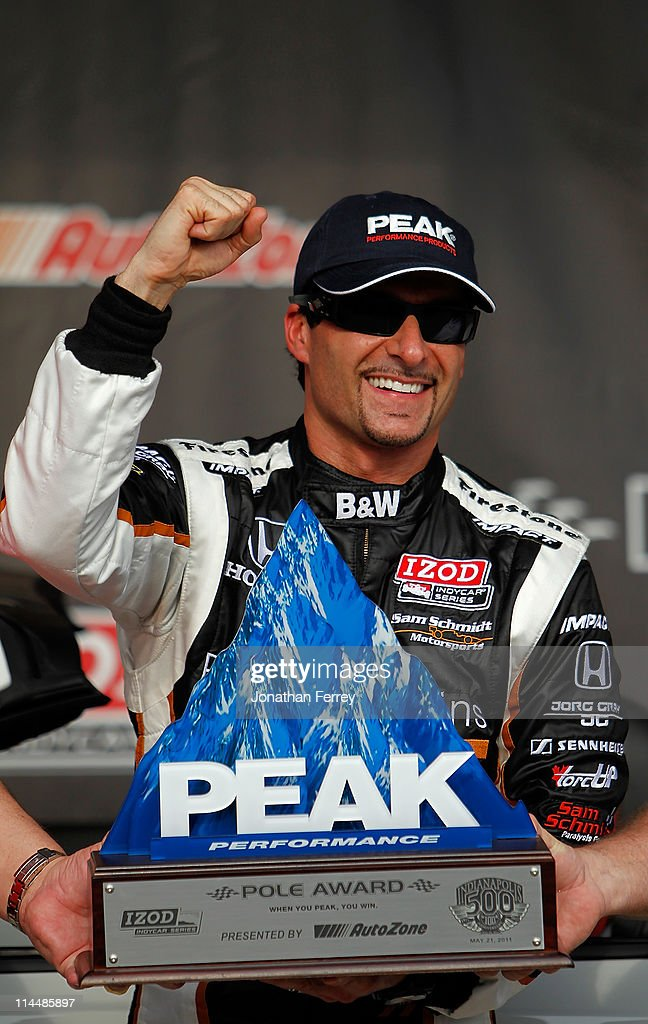 <a gi-track='captionPersonalityLinkClicked' href=/galleries/search?phrase=Alex+Tagliani&family=editorial&specificpeople=220628 ng-click='$event.stopPropagation()'>Alex Tagliani</a> driver of the #77 Bowers & Wilkens/Sam Schmidt Motorsports Dallara Honda celebrates winning the pole position during qualifying for the the 95th Indianapolis 500 Mile Race at the Indianapolis Motor Speedway on May 21, 2011 in Indianapolis, Indiana.