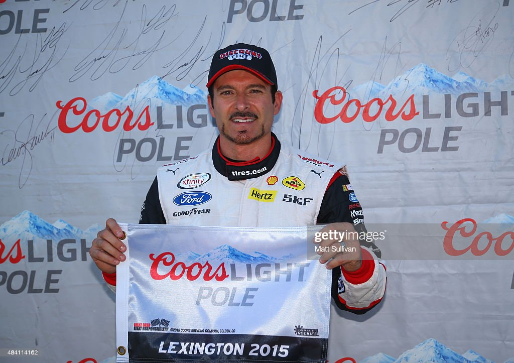 <a gi-track='captionPersonalityLinkClicked' href=/galleries/search?phrase=Alex+Tagliani&family=editorial&specificpeople=220628 ng-click='$event.stopPropagation()'>Alex Tagliani</a>, driver of the #22 Discount Tire Ford, poses for pictures after winning the pole for the 3rd Annual Nationwide Children's Hospital 200 at Mid-Ohio Sports Car Course on August 15, 2015 in Lexington, Ohio.