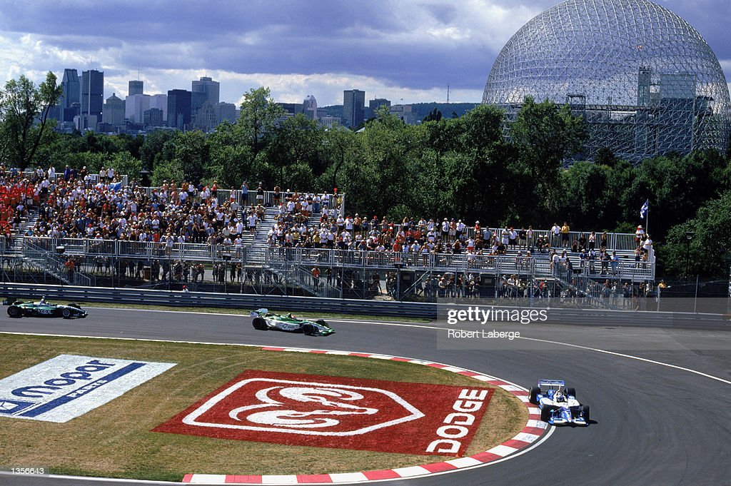Alex Tagliani #33 drives his Players Forsythe Ford Reynard past Shinji Nakano #52 of Japan in his Fernandez Racing Honda Lola and Paul Tracy #26 in his Team Kool Green Honda Lola during the Molson Indy Montreal, round 13 of the CART Fed Ex Championship Series on August 25, 2002 at the Circuit Gilles-Villeneuve in Montreal, Quebec, Canada.