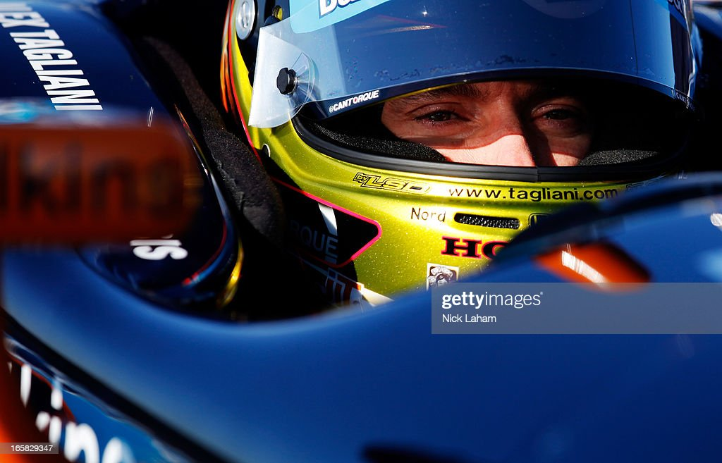 Alex Tagliani of Canada, driver of the #98 Barracuda Racing Honda, sits in his car during practice for the Honda Indy Grand Prix of Alabama at Barber Motorsports Park on April 6, 2013 in Birmingham, Alabama.
