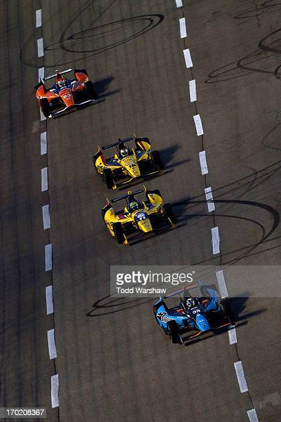 Alex Tagliani of Canada driver of the Barracuda Racing/Bryan Herta Autosport w/ CurbAgajanian Honda leads Graham Rahal driver of the Midas/Big O...