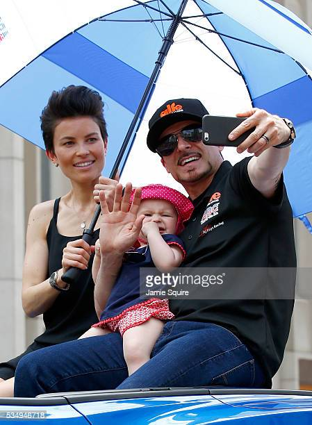 Alex Tagliani of Canada driver of the Dallara Honda takes a selfie with his family during a parade ahead of the 100th running of the Indianapolis 500...