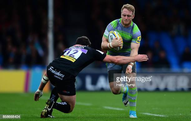 Alex Tait of Newcastle Falcons is tackled by Ian Whitten of Exeter Chiefs during the Aviva Premiership match between Exeter Chiefs and Newcastle...