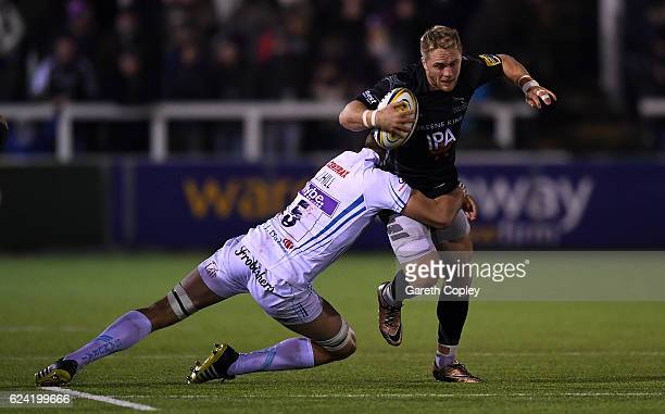 Alex Tait of Newcastle is tackled by Jonny Hill of Exeter during the Aviva Premiership match between Newcastle Falcons and Exeter Chiefs at Kingston...