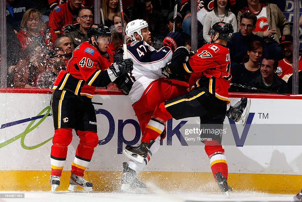 <a gi-track='captionPersonalityLinkClicked' href=/galleries/search?phrase=Alex+Tanguay&family=editorial&specificpeople=203231 ng-click='$event.stopPropagation()'>Alex Tanguay</a> #40 and <a gi-track='captionPersonalityLinkClicked' href=/galleries/search?phrase=Blake+Comeau&family=editorial&specificpeople=879782 ng-click='$event.stopPropagation()'>Blake Comeau</a> #17 of the Calgary Flames collide with <a gi-track='captionPersonalityLinkClicked' href=/galleries/search?phrase=Dalton+Prout&family=editorial&specificpeople=6263673 ng-click='$event.stopPropagation()'>Dalton Prout</a> #47 of the Columbus Blue Jackets on March 29, 2013 at the Scotiabank Saddledome in Calgary, Alberta, Canada.