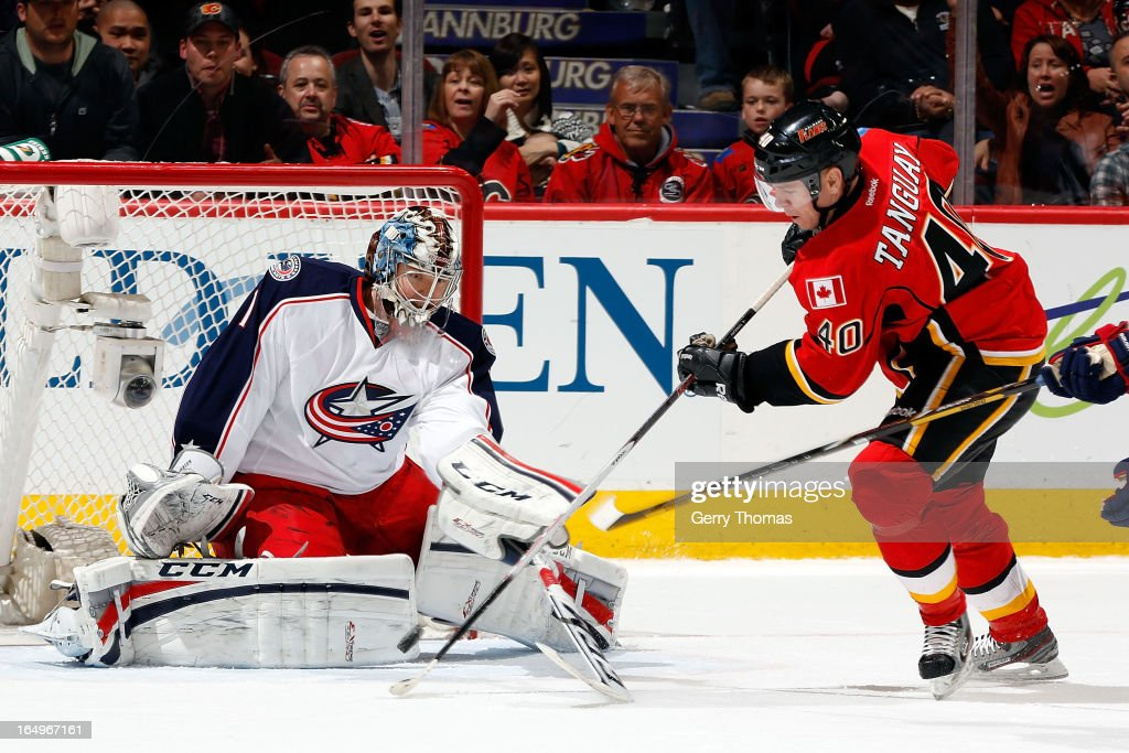 <a gi-track='captionPersonalityLinkClicked' href=/galleries/search?phrase=Alex+Tanguay&family=editorial&specificpeople=203231 ng-click='$event.stopPropagation()'>Alex Tanguay</a> #40 of the Calgary Flames shoots the puck against Steve Mason #1 of the Columbus Blue Jackets on March 29, 2013 at the Scotiabank Saddledome in Calgary, Alberta, Canada.