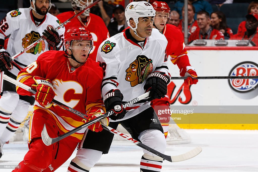 <a gi-track='captionPersonalityLinkClicked' href=/galleries/search?phrase=Alex+Tanguay&family=editorial&specificpeople=203231 ng-click='$event.stopPropagation()'>Alex Tanguay</a> #40 of the Calgary Flames skates against Jamal Meyers #22 of the Chicago Blackhawks on February 2, 2013 at the Scotiabank Saddledome in Calgary, Alberta, Canada.