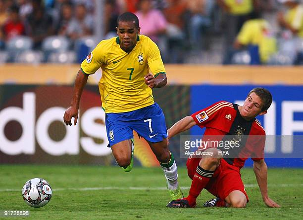 Alex Teixeira of Brazil beats Sebastian Jung of Germany during the FIFA U20 World Cup Quarter Final match between Brazil and Germany at the Cairo...