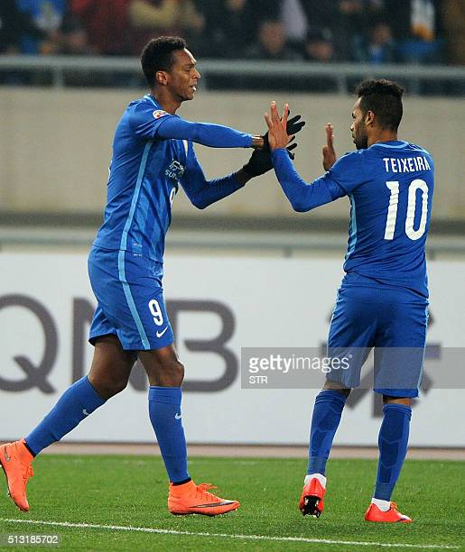 Alex Teixeira of China's Jiangsu FC celebrates with teammate Joao Alves after scoring a goal against South Korea's Jeonbuk during their AFC Champions...