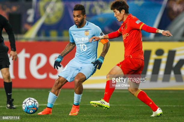 Alex Teixeira of Jiangsu Suning and Kim JaeSung of Adelaide United compete for the ball during the AFC Champions League 2017 Group H match between...