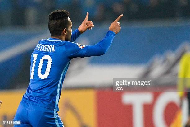 Alex Teixeira of Jiangsu Suning celebrates after scoring his team's first goal during the AFC Champions League Group E match between Jiangsu Suning...