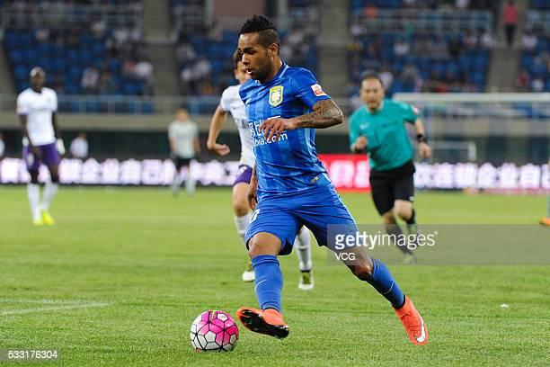 Alex Teixeira of Jiangsu Suning drives the ball during Chinese Football Association Super League Round 10 between Tianjin Teda and Jiangsu Suning at...