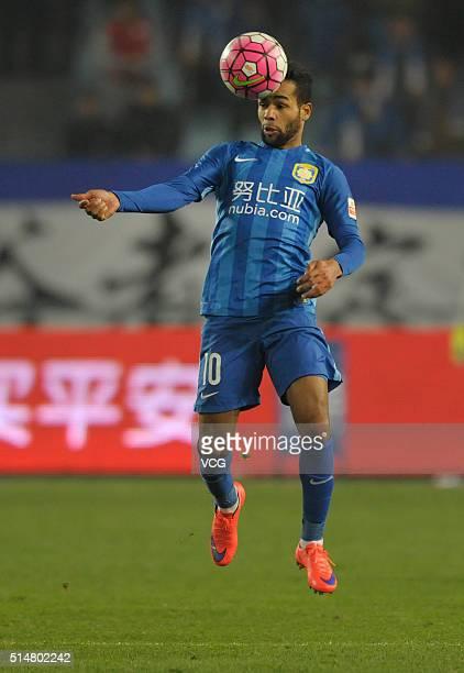 Alex Teixeira of Jiangsu Suning drives the ball during the Chinese Football Association Super League match between Jiangsu Suning and Yanbian Funde...