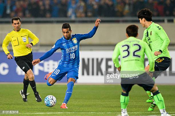 Alex Teixeira of Jiangsu Suning scores his team's first goal during the AFC Champions League Group E match between Jiangsu Suning and Jeonbuk Hyundai...