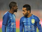 Alex Teixeira of Jiangsu Suning speaks with Ramires during the Chinese Football Association Super League match between Jiangsu Suning and Yanbian...