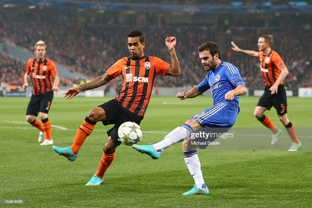 Alex Teixeira (L) of Shakhtar Donetsk blocks a cross from Juan Mata (R) of Chelsea during the UEFA Champions League Group E match between Shakhtar Donetsk and Chelsea at the Donbass Arena on October 23, 2012 in Donetsk, Ukraine.