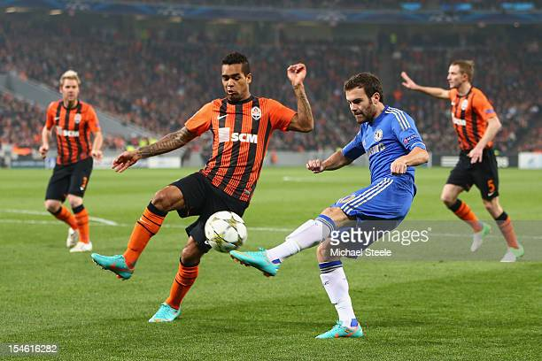 Alex Teixeira of Shakhtar Donetsk blocks a cross from Juan Mata of Chelsea during the UEFA Champions League Group E match between Shakhtar Donetsk...