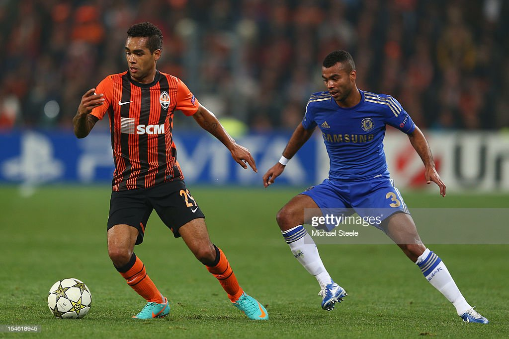 Alex Teixeira (L) of Shakhtar Donetsk is tracked by Ashley Cole (R) of Chelsea during the UEFA Champions League Group E match between Shakhtar Donetsk and Chelsea at the Donbass Arena on October 23, 2012 in Donetsk, Ukraine.