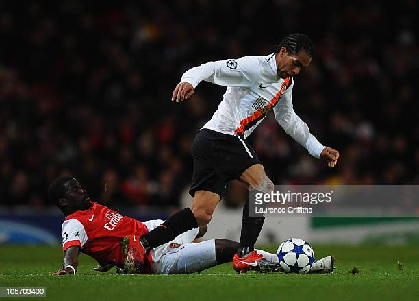 Alex Teixeira of Shakhtar Donetsk takes on Emmanuel Eboue of Arsenal during the UEFA Champions League Group H match between Arsenal and FC Shakhtar...