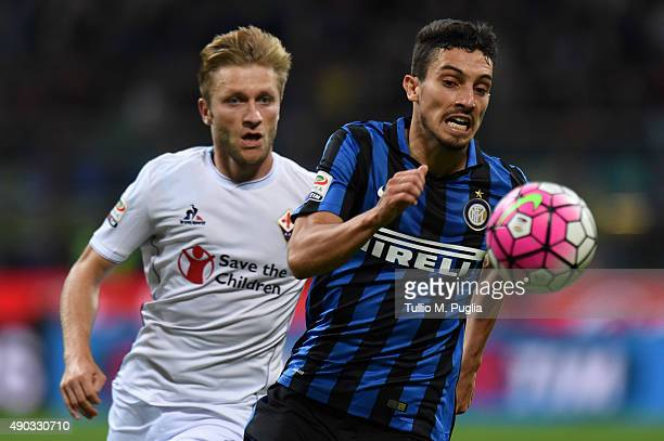 Alex Teller of Internazionale Milano is challenged by Jakub Blaszczykowski of Fiorentina during the Serie A match between FC Internazionale Milano...