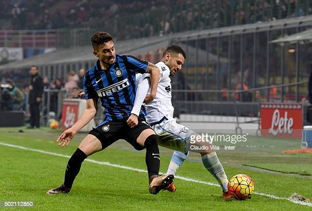 Alex Telles of FC Internazionale and Antonio Candreva of SS Lazio compete for the ball during the Serie A match between FC Internazionale Milano and...