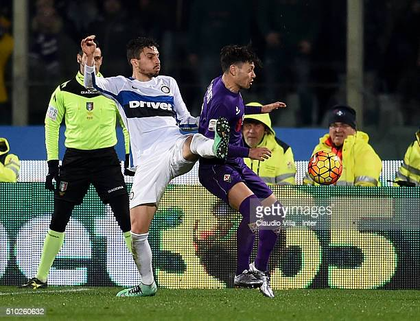 Alex Telles of FC Internazionale and Mauro Zarate of ACF Fiorentina compete for the ball during the Serie A match between ACF Fiorentina and FC...