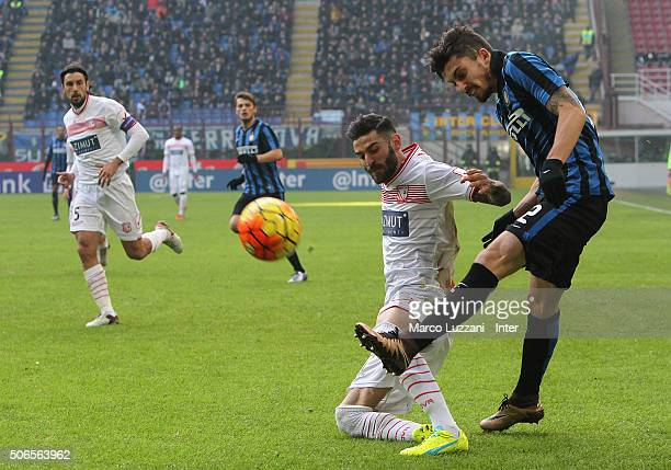 Alex Telles of FC Internazionale Milano competes for the ball with Marco Crimi of Carpi FC during the Serie A match between FC Internazionale Milano...