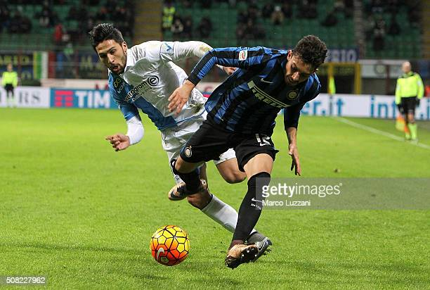 Alex Telles of FC Internazionale Milano competes for the ball with Lucas Nahuel Castro of AC Chievo Verona during the Serie A match between FC...