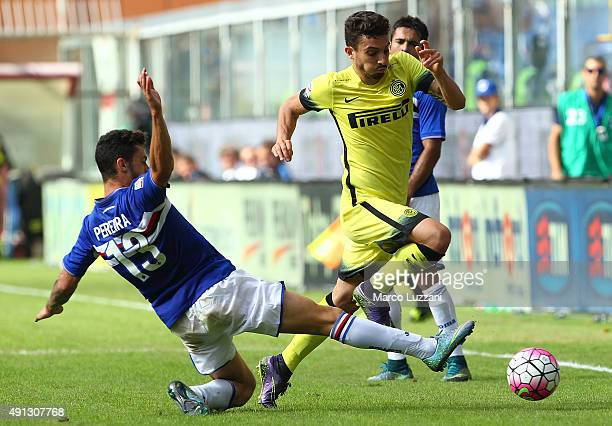 Alex Telles of FC Internazionale Milano is challenged by Pedro Miguel Pereira of UC Sampdoria during the Serie A match between UC Sampdoria and FC...