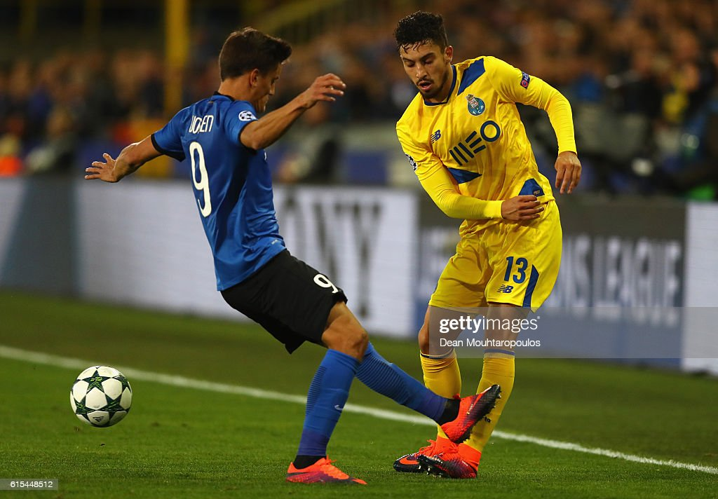 Alex Telles of FC Porto and Jelle Vossen of Club Brugge compete for the ball during the UEFA Champions League Group G match between Club Brugge KV and FC Porto at Jan Breydel Stadium on October 18, 2016 in Bruges, Belgium.