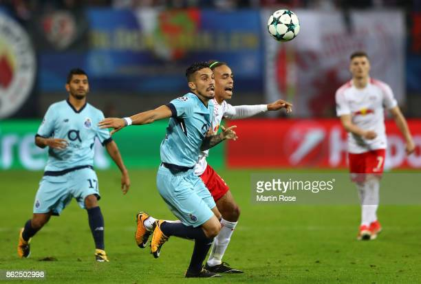 Alex Telles of FC Porto and Yussuf Poulsen of RB Leipzig battle for posession during the UEFA Champions League group G match between RB Leipzig and...