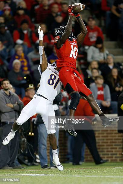 Alex Thomas of the Cincinnati Bearcats intercepts a pass intended for Jimmy Williams of the East Carolina Pirates during the second quarter at...