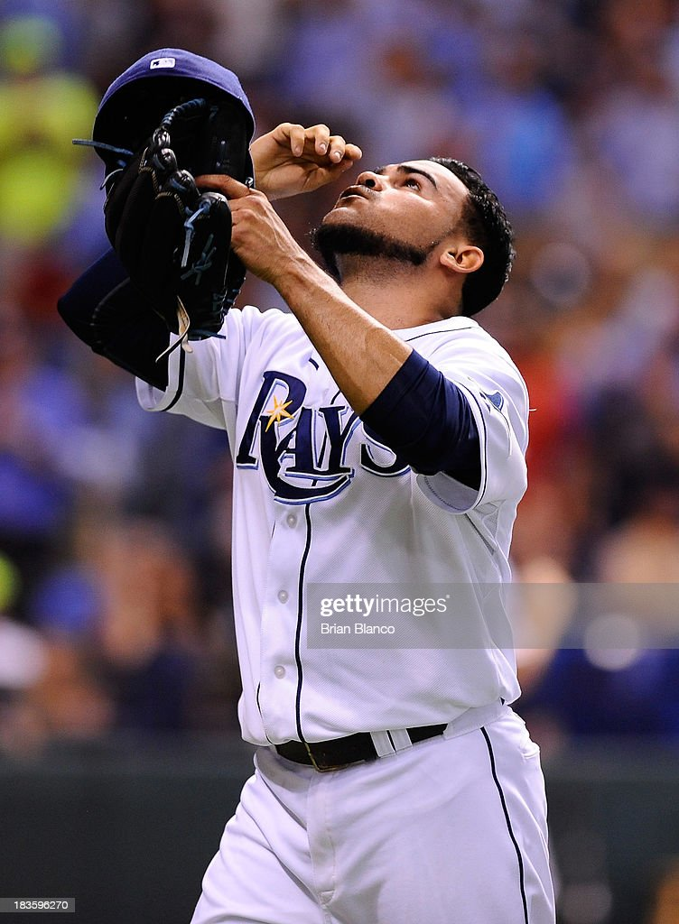 Alex Torres #54 of the Tampa Bay Rays reacts after a strike out to end the sixth inning against the Boston Red Sox during Game Three of the American League Division Series at Tropicana Field on October 7, 2013 in St Petersburg, Florida.