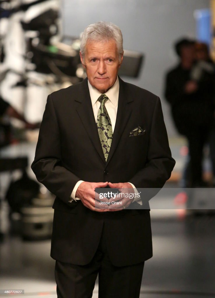 <a gi-track='captionPersonalityLinkClicked' href=/galleries/search?phrase=Alex+Trebek&family=editorial&specificpeople=595944 ng-click='$event.stopPropagation()'>Alex Trebek</a> appears onstage during 'Hot In Cleveland' LIVE! at the CBS Studio Center on March 26, 2014 in Studio City, California.