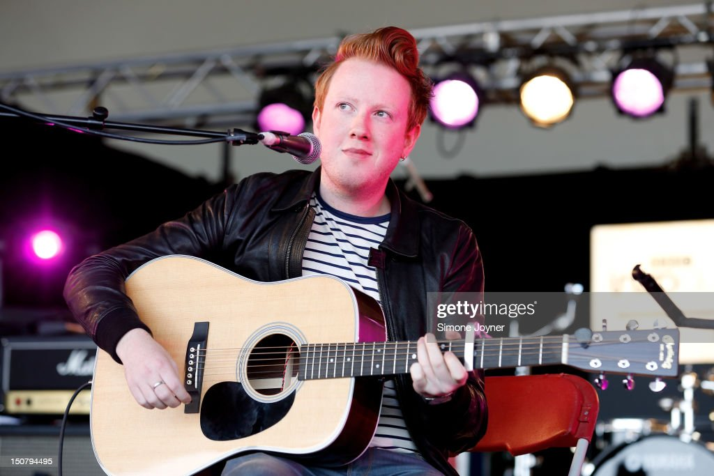 <a gi-track='captionPersonalityLinkClicked' href=/galleries/search?phrase=Alex+Trimble&family=editorial&specificpeople=6920992 ng-click='$event.stopPropagation()'>Alex Trimble</a> of Two Door Cinema Club performs live on the BBC Introducing Stage on Day Three during the Reading Festival 2012 at Richfield Avenue on August 26, 2012 in Reading, England. Two Door Cinema Club, played a secret acoustic set ahead of their headline set on Radio 1 NME stage this evening.