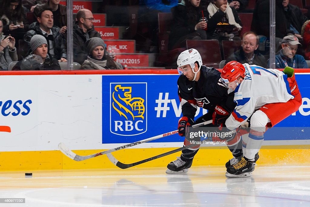 Alex Tuch #17 of Team United States and Rushan Rafikov #7 of Team Russia chase the puck in a quarterfinal round during the 2015 IIHF World Junior Hockey Championships at the Bell Centre on January 2, 2015 in Montreal, Quebec, Canada. Team Russia defeated Team United States 3-2.